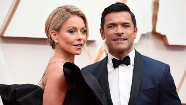 PHOTO: Kelly Ripa, left, and Mark Consuelos arrive at the Oscars, Feb. 9, 2020, at the Dolby Theatre in Los Angeles. (Jordan Strauss/Invision/AP)