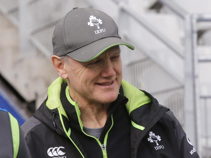 FILE - In this file photo dated Friday, Feb. 2, 2018, Ireland head coach Joe Schmidt arrives for their captain's run at Stade de France stadium Denis, outside Paris, France. Ireland meet Wales for the deciding match upcoming Saturday March 16, 2019, with Wales naming an unchanged side for its Six Nations Grand Glam. (AP Photo/Michel Euler, FILE)