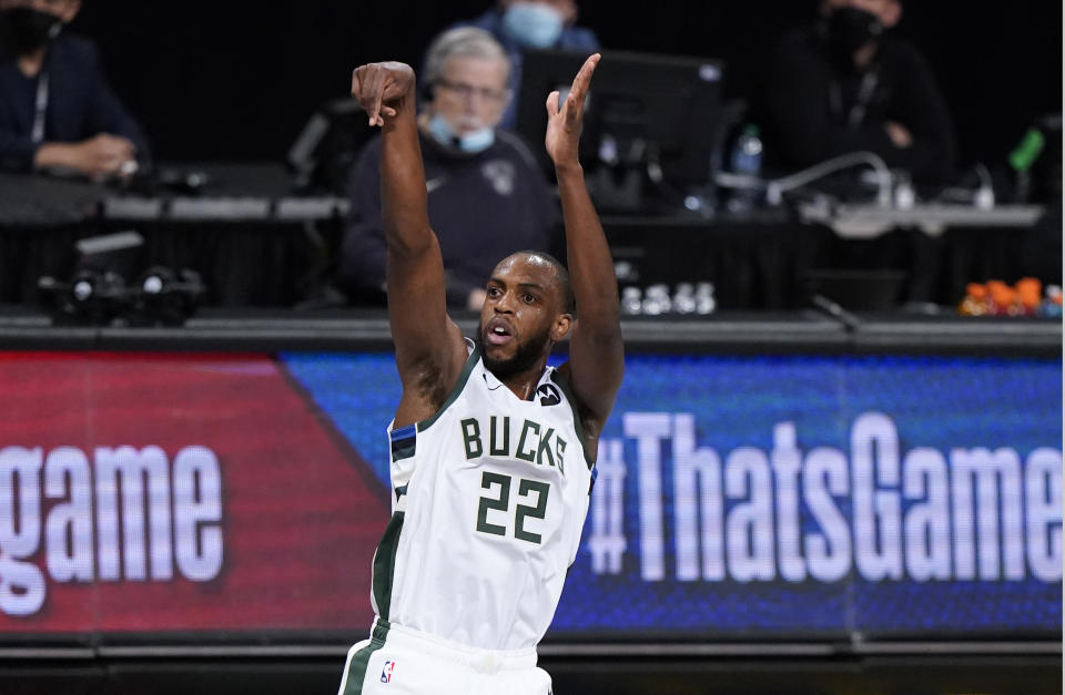 Milwaukee Bucks forward Khris Middleton (22) tracks his three-point shot in Game 5 of a second-round NBA basketball playoff series against the Brooklyn Nets, Tuesday, June 15, 2021, in New York. (AP Photo/Kathy Willens)