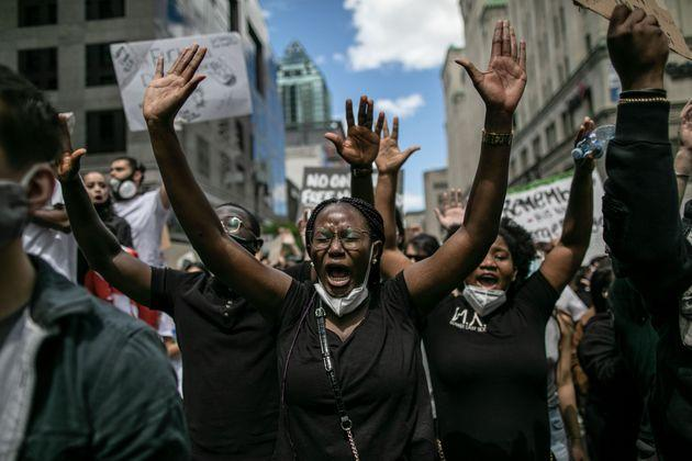 Protesters march against police brutality and racism in Montreal, just over a week after George Floyd's death.