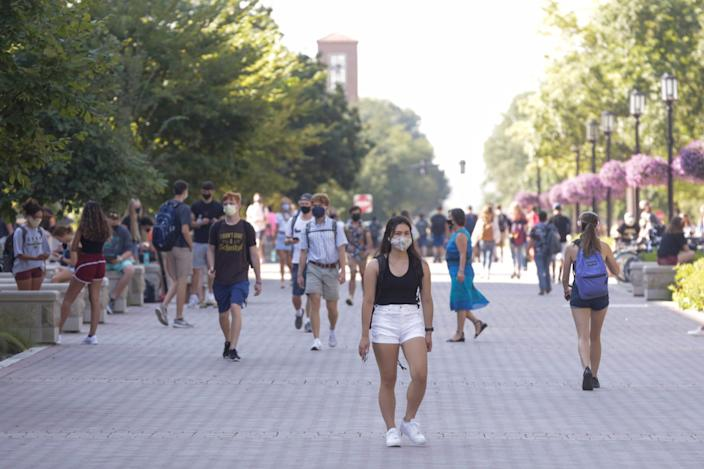 Students walk across Purdue University's campus Monday in West Lafayette.
