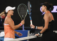 Australia's Ash Barty, left, is congratulated by Spain's Garbine Muguruza after winning the final of the Yarra River Classic in Melbourne, Australia, Sunday, Feb. 7, 2021.(AP Photo/Andy Brownbill)