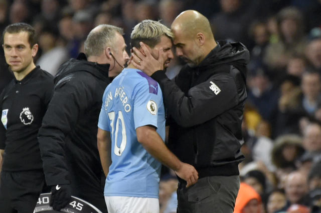 Manchester City's head coach Pep Guardiola, right, talks with Sergio Aguero as he is substituted after getting injured during the English Premier League soccer match between Manchester City and Chelsea at Etihad stadium in Manchester, England, Saturday, Nov. 23, 2019. (AP Photo/Rui Vieira)