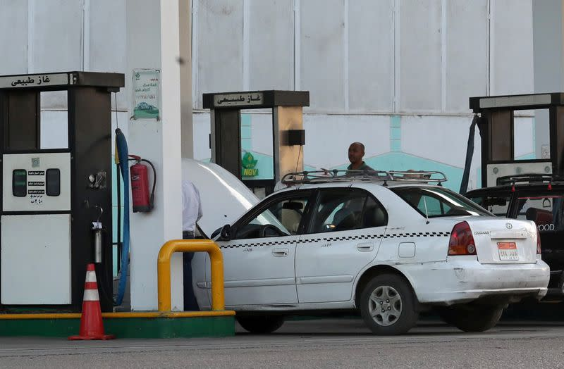 A taxi is filled up with gas at Natural Gas Vehicles (NGV) petrol station in Cairo