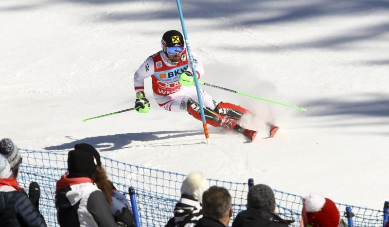 Austria's Marcel Hirscher speeds down the course on his way to win an alpine ski, men's World Cup slalom in Wengen, Switzerland, Sunday, Jan. 14, 2018. (AP Photo/Alessandro Trovati)