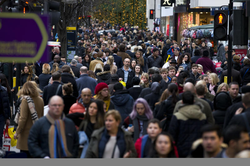 People doing last minute Christmas shopping on Oxford Street in central London on December 23, 2014