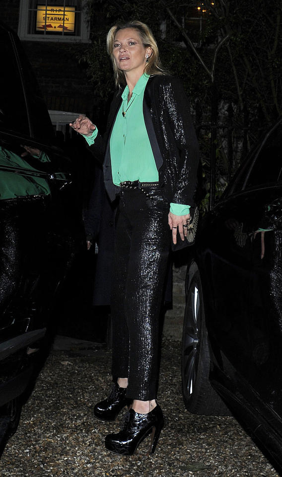 <p>While this outfit may have been worn on Moss' birthday eve in London, the glitz and glam sure makes it seem like a more than appropriate birthday suit. The supermodel dazzled in a tailored black sequin set (the blazer from her bespoke Topshop collection), a silk green shirt (sans bra) and patent leather booties. (<i>Splash News) </i></p>