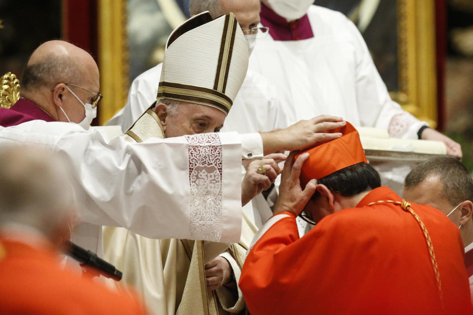 Italian newly Cardinal Augusto Paolo Lojudice receives his biretta as he is appointed cardinal by Pope Francis, during a consistory ceremony where 13 bishops were elevated to a cardinal's rank in St. Peter's Basilica at the Vatican, Saturday, Nov. 28, 2020. (Fabio Frustaci/POOL via AP)