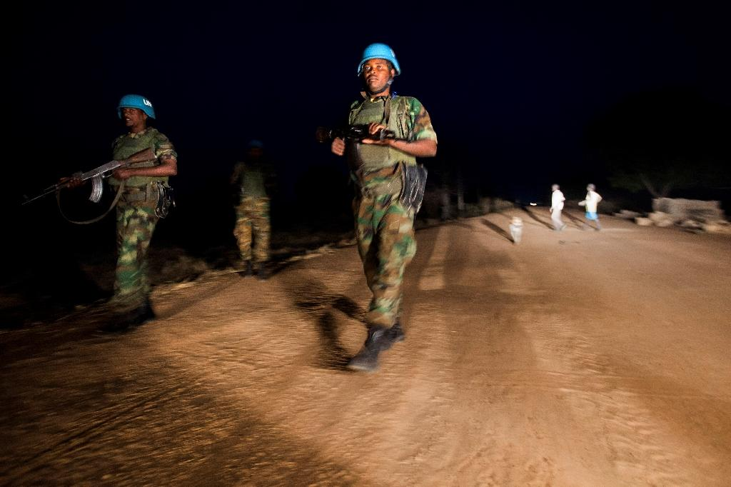 Peacekeeper troops from the United Nations (UN) Interim Security Force for Abyei patrol at night in South Sudan in December 2016 (AFP Photo/Albert Gonzalez Farran)