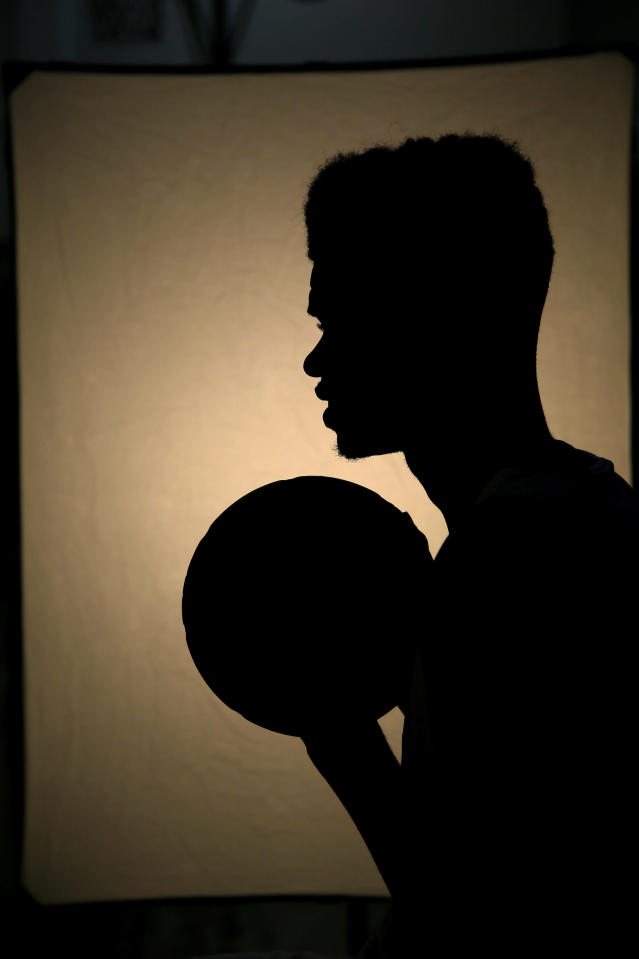 Philadelphia 76ers' Nerlens Noel is silhouetted as he poses for a photographer during NBA basketball media day at the team's practice facility, Friday, Sept. 27, 2013, in Philadelphia. (AP Photo/Matt Slocum)