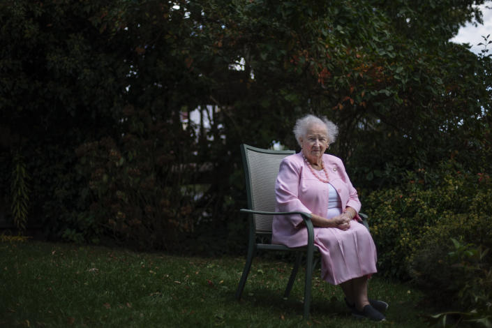 """Ginny Mucciaccio, 90, a direct descendant of a Pilgrim who came over on the Mayflower, sits for a portrait in Plymouth, Mass., Thursday, Oct. 1, 2020. Mucciacco, a descendant of Mayflower passenger Degory Priest, said the Pilgrims' work ethic was admirable. """"To have this tie to our early history is really, I won't say it's a privilege, an honor. But it's just something to be proud of because so many of them worked so hard, for so many years to help establish this country. And it's just very important to me,"""" said Mucciacco. """"We just have a hard working history in my family going back. We've worked for everything that they have. And I still work two days a week."""" (AP Photo/David Goldman)"""