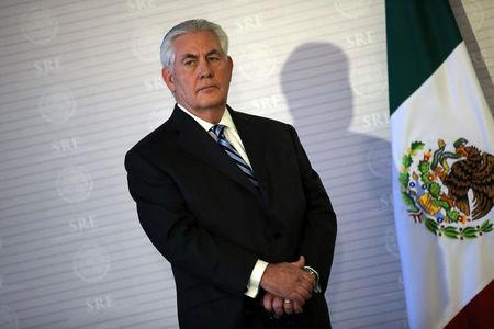 U.S. Secretary of State Tillerson stands next to a Mexican flag during a join statement with Mexico's Foreign Secretary Videgaray at the Ministry of Foreign Affairs in Mexico City