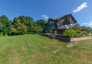 """<p>Set in an acre of rural grounds within the Norfolk Broads National Park, Mole Emd has beautiful views over fields and streams. There's also an enclosed garden with a private orchard and wildflower meadow. </p><p><strong>Guests: </strong>Up to 11</p><p><strong>Pricing: </strong>From £292 per night</p><p><a class=""""link rapid-noclick-resp"""" href=""""https://go.redirectingat.com?id=127X1599956&url=https%3A%2F%2Fwww.plumguide.com%2Fhomes%2F34672%2Fmole-end%3Fguests%3D11&sref=https%3A%2F%2Fwww.countryliving.com%2Fuk%2Ftravel-ideas%2Fstaycation-uk%2Fg35804522%2Fgroup-accommodation-holiday-homes-uk%2F"""" rel=""""nofollow noopener"""" target=""""_blank"""" data-ylk=""""slk:BOOK NOW"""">BOOK NOW</a></p>"""