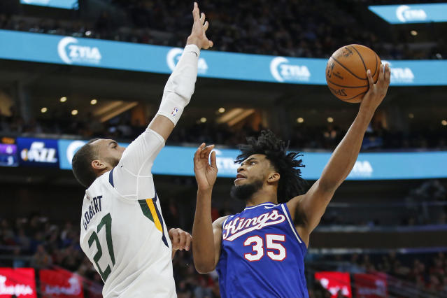 Utah Jazz center Rudy Gobert (27) defends against Sacramento Kings forward Marvin Bagley III (35) during the first half of an NBA basketball game Saturday, Jan. 18, 2020, in Salt Lake City. (AP Photo/Rick Bowmer)
