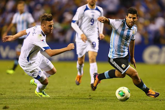 ST. LOUIS, MO - NOVEMBER 18: Sergio Aguero #10 of Argentina controls the ball against Ermin Bicakcic #3 of Bosnia-Herzegovina during the international friendly match between Bosnia-Herzegovina and Argentina at Busch Stadium on November 18, 2013 in St. Louis, Missouri. (Photo by Dilip Vishwanat/Getty Images)