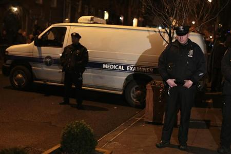 Police officers stand in front of a Medical Examiners vehicle as they remove the body of actor Philip Seymour Hoffman outside the apartment building where he was found dead in Manhattan, New York February 2, 2014. REUTERS/John Taggart