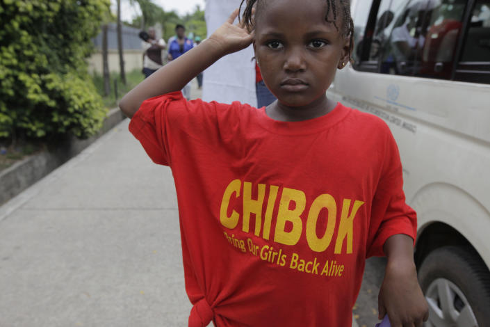 A girl wearing a T-Shirt with the inscription '' Chibok brings our girls back Alive'' attends a demonstration calling on government to rescue kidnapped school girls of a government secondary school Chibok, during workers day celebration in Lagos, Nigeria. Thursday, May, 1. 2014, Scores of girls and young women kidnapped from a school in Nigeria are being forced to marry their Islamic extremist abductors, a civic organization reported Wednesday. At the same time, the Boko Haram terrorist network is negotiating over the students' fate and is demanding an unspecified ransom for their release, a Borno state community leader told The Associated Press. He said the Wednesday night message from the abductors also claimed that two of the girls have died from snake bites. The message was sent to a member of a presidential committee mandated last year to mediate a ceasefire with the Islamic extremists, said the civic leader, who spoke on condition of anonymity because he is not authorized to speak about the talks. (AP Photo/ Sunday Alamba)