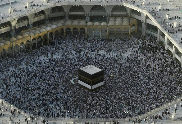 Muslim pilgrims gather in August 2019 around the Kaaba, Islam's holiest shrine, at the Grand Mosque in Saudi Arabia's holy city of Mecca prior to the start of last year's hajj pilgrimage (AFP Photo/FETHI BELAID)