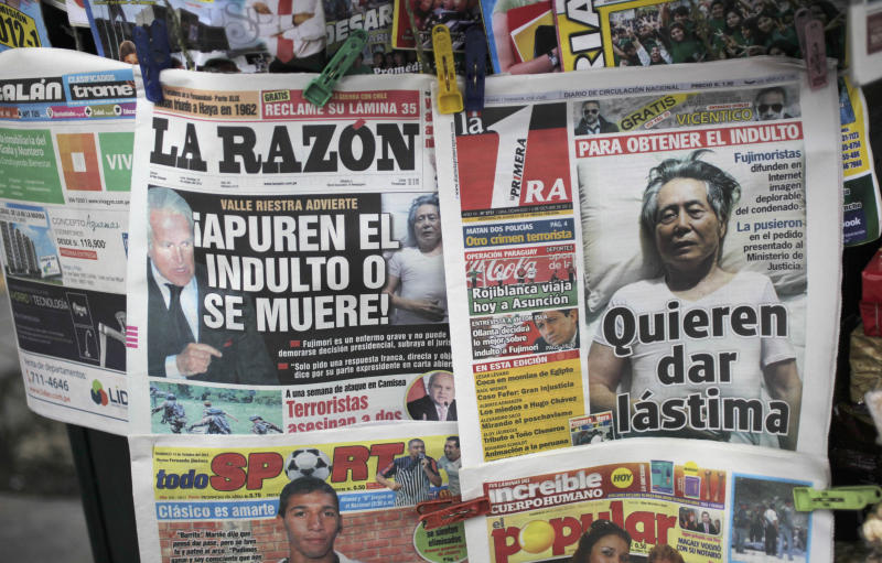 "In this Oct. 14, 2012 photo, the front page of a newspaper shows a photograph of Peru's former President Alberto Fujimori laying in a bed as he serves jail time that reads in Spanish ""They want you to feel sorry for him"" in Lima, Peru.  A campaign is in full swing to win a pardon for Fujimori from the 25-year prison sentence he is serving for death squad killings and corruption during his 1990-2000 rule. (AP Photo/Rodrigo Abd)"