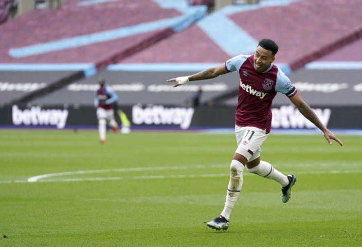 West Ham's Jesse Lingard celebrates after scoring his side's second goal during the English Premier League soccer match between West Ham United and Leicester City at the London Stadium in London, Sunday, April 11, 2021. (John Walton/Pool via AP)