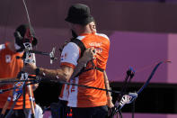Second placed Gabriela Schloesser and Steve Wijler of the Netherlands celebrate at the end the mixed team semifinal against Turkey at the 2020 Summer Olympics, Saturday, July 24, 2021, in Tokyo, Japan. (AP Photo/Alessandra Tarantino)