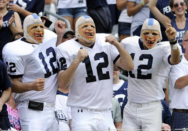 Penn State fans cheer during the first quarter of an NCAA college football game against Syracuse Saturday, Aug. 31, 2013, in East Rutherford, N.J. (AP Photo/Bill Kostroun)