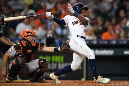 May 22, 2018; Houston, TX, USA; Houston Astros second baseman Tony Kemp (18) hits a two-RBI single during the seventh inning against the San Francisco Giants at Minute Maid Park. Mandatory Credit: Shanna Lockwood-USA TODAY Sports