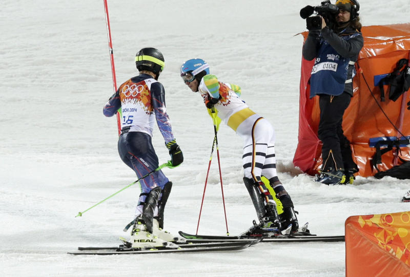 United States' Ted Ligety, left, and Germany's Felix Neureuther talk after they both skied out of the second run of the men's slalom at the Sochi 2014 Winter Olympics, Saturday, Feb. 22, 2014, in Krasnaya Polyana, Russia. (AP Photo/Gero Breloer)