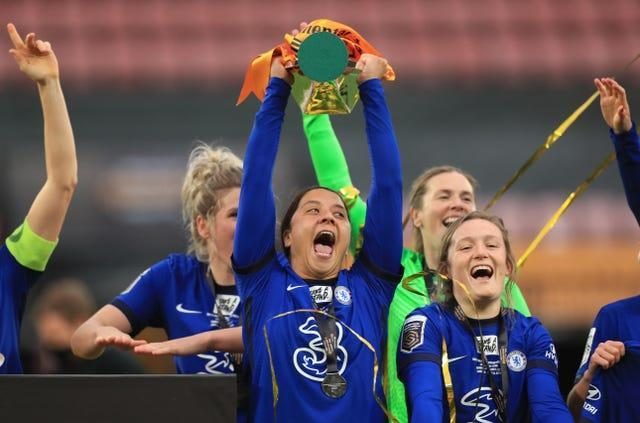 Sam Kerr (centre) celebrates with the trophy after her hat-trick helped Chelsea beat Bristol City 6-0 in the Continental League Cup final at Vicarage Road (Mike Egerton/PA).