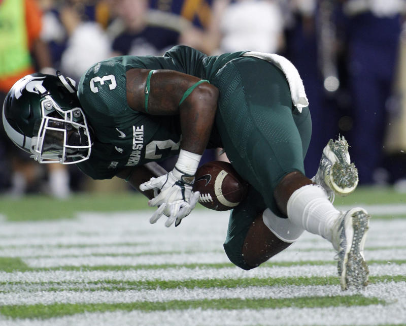 Michigan State RB LJ Scott charged with driving with a suspended license