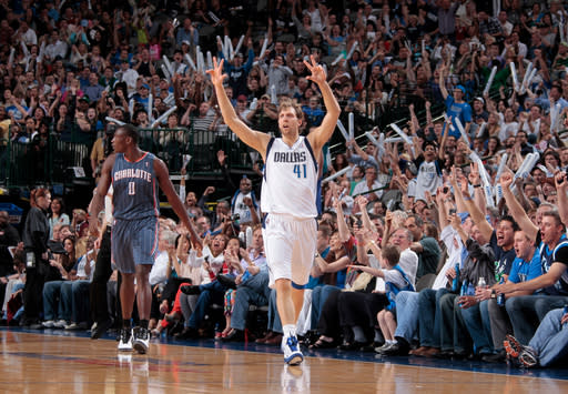 DALLAS, TX - MARCH 15: Dirk Nowitzki #41 of the Dallas Mavericks celebrates hitting a three-pointer against the Charlotte Bobcats on March 15, 2012 at the American Airlines Center in Dallas, Texas. (Photo by Danny Bollinger/NBAE via Getty Images)