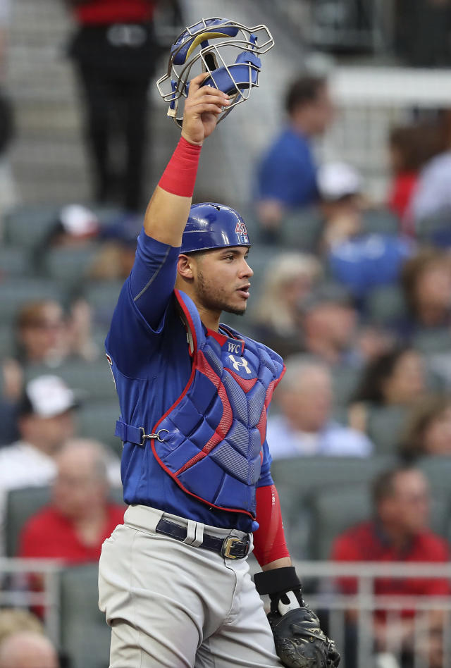 Chicago Cubs catcher Willson Contreras salutes center fielder Albert Almora Jr. after he went to the wall to rob Atlanta Braves'Tyler Flowers of a home run during the second inning of a baseball game Wednesday, May 16, 2018, in Atlanta. (Curtis Compton/Atlanta Journal-Constitution via AP)