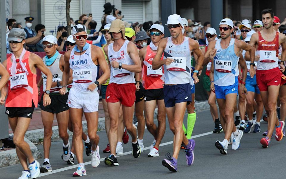 Yohann Diniz, centre, pulled out in the heat of the men's 50km - Getty Images