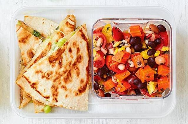 """<p>It's a far cry from the days or turkey twizzlers, as this cheesy quesadilla and rainbow salad is something we wouldn't mind taking to work… It takes just 15 minutes to prepare and is sure to keep kids tired of sandwiches content. For the full recipe, visit <a href=""""https://realfood.tesco.com/recipes/cheesy-quesadilla-with-rainbow-salad.html"""" rel=""""nofollow noopener"""" target=""""_blank"""" data-ylk=""""slk:Tesco"""" class=""""link rapid-noclick-resp"""">Tesco</a>. </p>"""