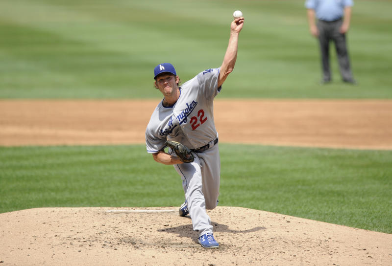 Los Angeles Dodgers starting pitcher Clayton Kershaw delivers against the Washington Nationals during the third inning of a baseball game on Sunday, July 21, 2013, in Washington. (AP Photo/Nick Wass)