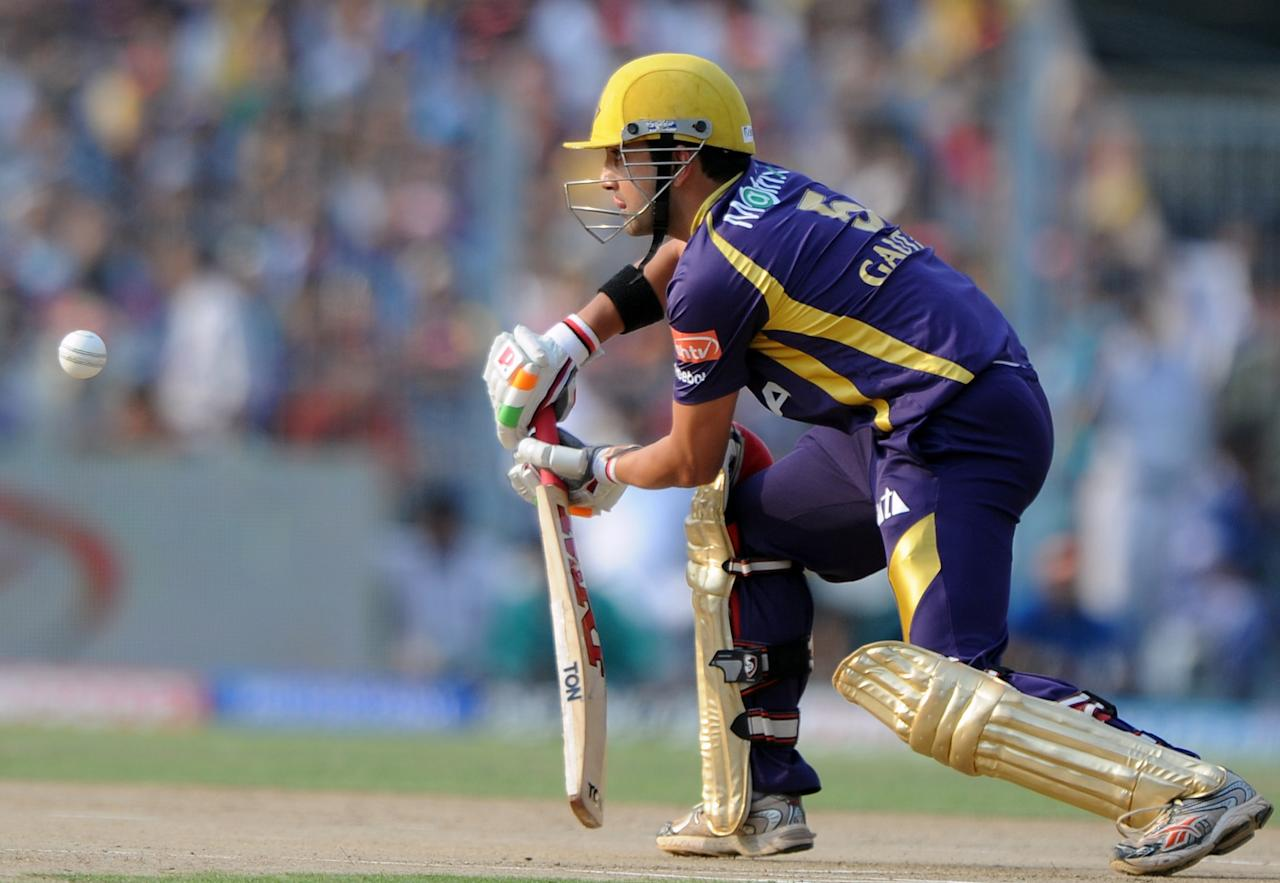 Kolkata Knight Riders batsman Gautam Gambhir plays a shot during the IPL Twenty20 cricket match between Kolkata Knight Riders and Pune Warriors at The Eden Gardens in Kolkata on May 3, 2012.  RESTRICTED TO EDITORIAL USE. MOBILE USE WITHIN NEWS PACKAGE.  AFP PHOTO/Dibyangshu SARKAR        (Photo credit should read DIBYANGSHU SARKAR/AFP/GettyImages)
