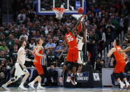 Syracuse forward Bourama Sidibe (35) defends on a shot from Michigan State guard Joshua Langford (1) during the second half of an NCAA men's college basketball tournament second-round game in Detroit, Sunday, March 18, 2018. Syracuse won 55-53. (AP Photo/Paul Sancya)
