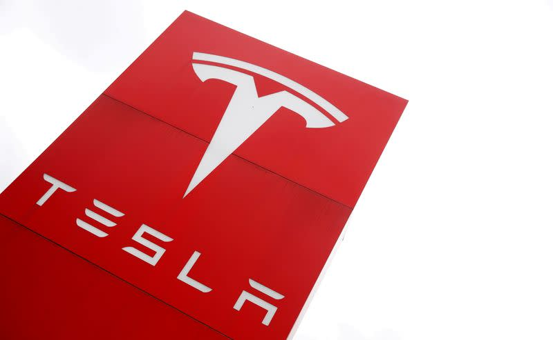 FILE PHOTO: The logo of car manufacturer Tesla is seen at a dealership in London