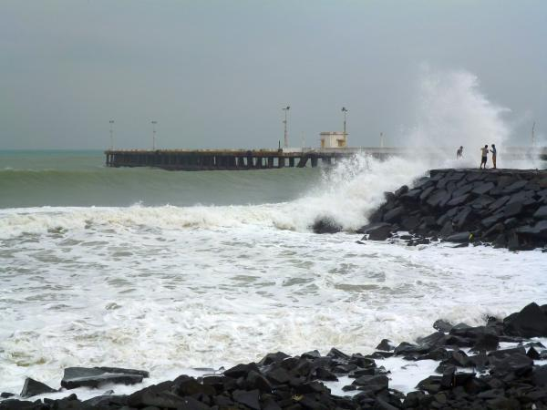 "Huge waves crash into the shore at Puducherry after Cyclone Thane unleashed havoc. Photo by Yahoo! reader Sankari Iyappan. She wrote in to say, ""The wind was whirling up, cracking glasses up and down, shattering and tearing off the branches, and it was a terrible experience."""