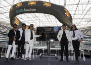"""Members of the Mexican grupera band Los Bukis, from left, Pedro Sanchez, Roberto Guadarrama, Marco Antonio Solis, on screen Joel Solis and Pepe Guadarrama, and Eusebio """"El Chivo"""" Cortez and Jose Javier Solis attend a press conference at SoFi Stadium on Monday, June 14, 2021, in Inglewood, Calif. Twenty five years after their last show as a band, the group announced that they are reuniting for a U.S. tour. (AP Photo/Chris Pizzello)"""