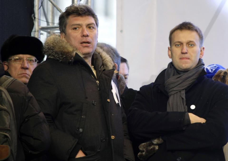 FILE - In this Dec. 24, 2011, file photo, from left, Russian former Financial Minister Alexei Kudrin, leaders of the opposition Boris Nemtsov and Alexei Navalny attend a rally to protest alleged vote rigging in Russia's parliamentary elections on Sakharov avenue in Moscow, Russia. Navalny is an anti-corruption campaigner and the Kremlin's fiercest critic. He has outlasted many opposition figures and is undeterred by incessant attempts to stop his work. (AP Photo/Misha Japaridze, File)