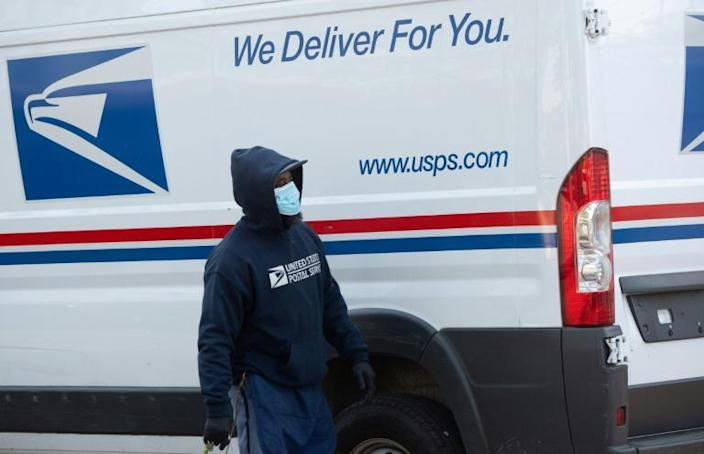 The US Postal Service is a mainstay of American life but has struggled to remain profitable in the age of digital communications -- and because of accumulated debt (AFP Photo/SAUL LOEB)