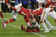 San Francisco 49ers' Tarvarius Moore, on the turf, clutches the ball after his interception against the Kansas City Chiefs during the second half of the NFL Super Bowl 54 football game Sunday, Feb. 2, 2020, in Miami Gardens, Fla. (AP Photo/Matt York)