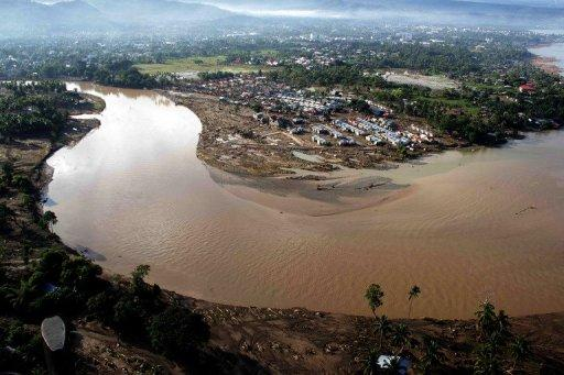 An aerial pictures shows the damge caused by devastating floods over Iligan City in the Philippines in  2011