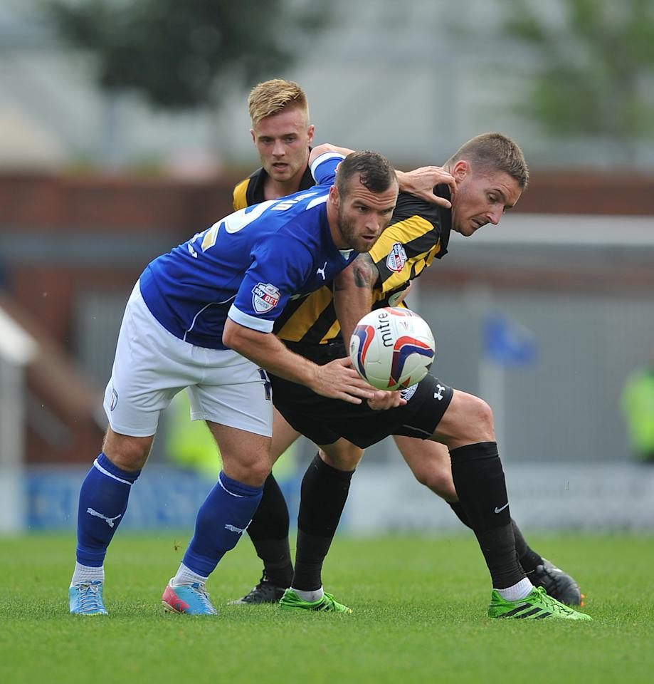 Southend United's Barry Corr and Chesterfield's Sam Hird battle for the ball during the Sky Bet Football League Two match at the Proact Stadium, Chesterfield.