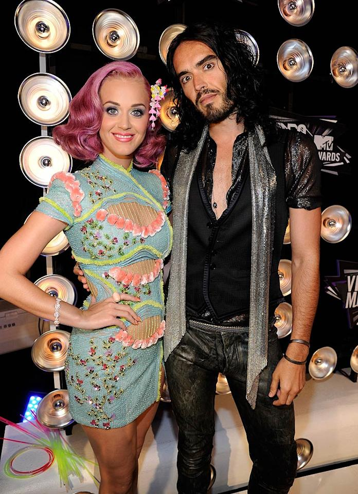 "As always, Katy Perry -- with hubby Russell Brand -- managed to stand out in the crowd thanks to her magenta locks and beaded Atelier Versace mini. Are you a fan of the pop star's new hair hue? Kevin Mazur/<a href=""http://www.wireimage.com"" target=""new"">WireImage.com</a> - August 28, 2011"