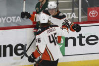 Anaheim Ducks' Max Comtois (53) celebrates with teammate Trevor Zegras (46) after scoring a goal against the Minnesota Wild during the first period of an NHL hockey game Friday, May 7, 2021, in St. Paul, Minn. (AP Photo/Stacy Bengs)