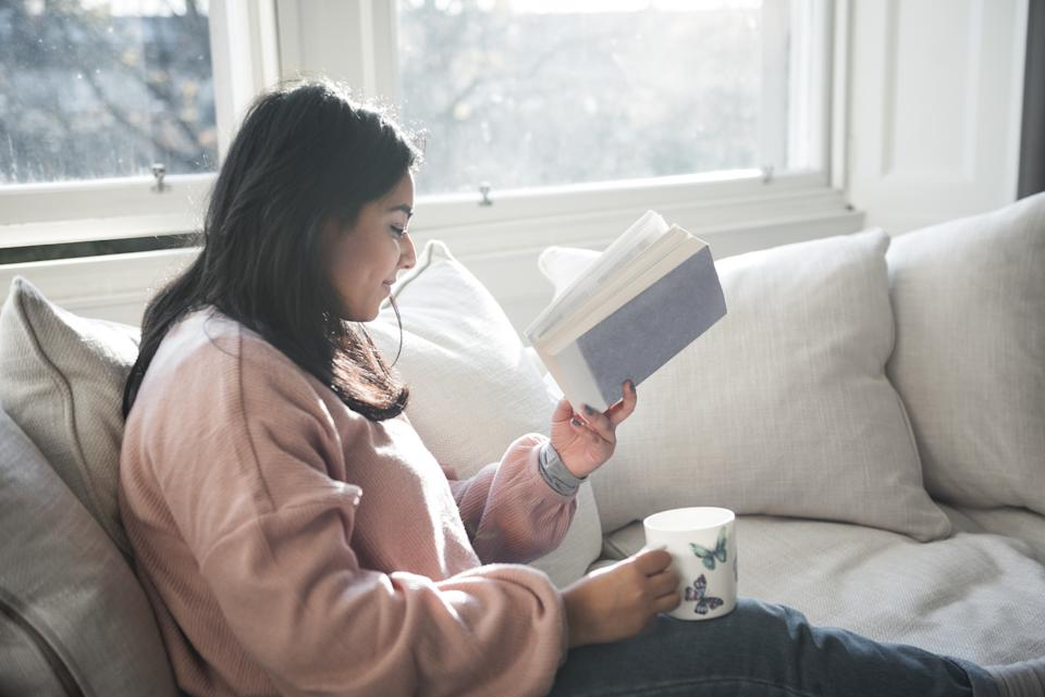 """Bibliotherapy"" can have mental health benefits during stressful times (Image via Getty Images)."