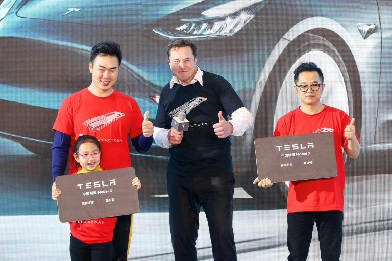 Tesla CEO Elon Musk (C), shown in Shanghai last month, has enjoyed a positive run in recent months at the expense of Detroit's Big Three (AFP Photo/STR)