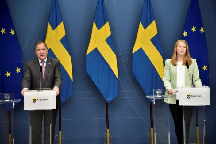 Swedish PM Lofven and Swedish Centre Party leader Loof attend a digital news conference in Stockholm